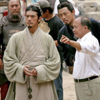 Talking tactics: John Woo talks directs Takeshi Kaneshiro, who plays military consultant Zhuge Liang, on the set of 'Red Cliff.' | AP PHOTO