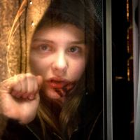 Bloodlust: Chloe Moretz plays Abby, a child who harbors a dark proclivity for the red stuff, in 'Let Me In.' Saeed Adyani | ©2010 Fish Head Productions, LLC All Rights Reserved.