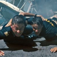 Buddies in bad times: Tadanobu Asano (left) and Taylor Kitsch take cover during an attack scene in the movie 'Battleship.'  The film is based on the popular American board game of the same name. | © 2012 UNIVERSAL STUDIOS. ALL RIGHTS RESERVED.