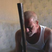 Heading for extinction: Peter Mullan as Joseph, a laborer wracked by booze-fueled anxiety and rage, in much-lauded British film 'Tyrannosaur.' | © CHANNEL FOUR TELEVISION/UK FILM COUNCIL/EM MEDIA/OPTIMUM RELEASING/WARP X/INFLAMMABLE FILMS 2010