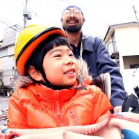 Smiling in the face of tragedy: A scene from 'Japan in a Day,' a documentary stitched together from public home-movie submissions shot in Japan on the first anniversary of the March 11 earthquake. &#169; 2012 fuji television network, japan in a day films ltd.
