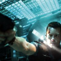 Gun of a kind: Snow (Guy Pearce) recalls the action peak of Bruce Willis as he takes on a space-prison full of bad dudes in 'Lockout.' | © 2011 EUROPACORP.