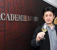 Top, Mineo Tachibana, general manager of Academie du Vin, is growing the school and aims to expand the courses it offers in English. Above, students take one of the school's many new classes. | YOSHIAKI MIURA PHOTO
