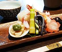The seasonal  otoshi  starter plate, including shrimp and bamboo shoots (top); and the monkey that gives the restaurant its name.