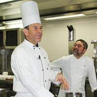 Executive Chef of the Greek Yacht Club, Konstantinos Vasalos (left) prepares the dough for his spanokopita dish while chef Kiyomi Mikuni watches on | NOBUKO HARA/GREEK NATIONAL TOURISM ORGANIZATION/HEPO PHOTOS