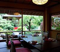 Every room has a garden view at Tofuya Ukai, where the traditional tofu cuisine (known as tofu kaiseki) and service (below) is as elegant as the setting. | ROBBIE SWINNERTON PHOTOS