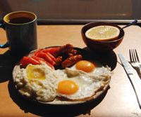 Served with eggs, grits (left) are crucial to a Southern breakfast. | JASON JENKINS PHOTO