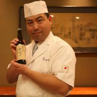 Delicate: Award-winning chef Kimio Nonaga holds a bottle of his brown-rice-based beer in his Nihonbashi Yukari kappo ryori restaurant. Below: Yukari beer's label reflects Nonaga's designer touch. | WILL ROBB PHOTOS