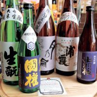 Five for the road: A lineup of Tohoku brews at Mitsuya Sake in Nishi-Ogikubo, Tokyo. The brands are (from left) Daishichi and Kokken (Fukushima), Tsuki no Wa (Iwate), Urakasumi (Miyagi) and Dewazakura (Yamagata). | MELINDA JOE PHOTO