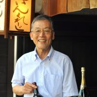 Respect for the aged: Yoshio Iwata (below) clutches a magnum of Ornellaia from 2005 outside his Kyoto store, Wine Crazy. Many of the bottles he sells are considerably older, such as this Prince de Montrouge Armagnac from 1934 (bottom) and a selection of early-20th-century ports (above). | JOHN ASHBURNE