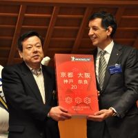 Star chef: Nobuhiro Yamamura (left) of Wa Yamamura is presented with his three stars by Michelin's Bernard Delmas. | JOHN ASHBURNE