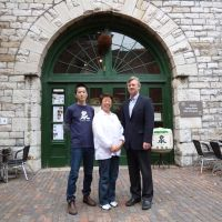 Community service (from left): Ontario Spring Water Sake Co. general manager Kazuto Hayashi, master brewer Yoshiko Takahashi and owner Ken Valvur pose in front of their Toronto brewery.
