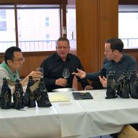 Nose for a winner (from left): International Wine Challenge sake division cochairs Kenichi Ohashi, Simon Hofstra and Sam Harrop participate in the tasting and evaluation of 689 sakes. The global contest was held last month; while it usually takes place in Britain, this year Japan hosted the sake assessment for the first time. | MELINDA JOE