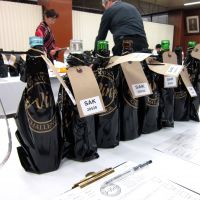 Love is blind: Bottles are concealed to ensure an unbiased tasting. Below: This year, 22 sake brands were awarded gold medals; the champion will be announced in September.