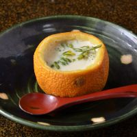 Flavor burst: Egg Custard With Flowering Mustard in Sour Orange Halves.