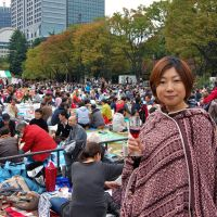 Thirst things first: A reveller toasts the camera at last weekend's Yamanashi Nouveau wine festival. | MELINDA JOE