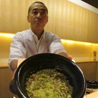 Favorite flavors: The pigeon-meat manju dumpling at Florilege in Aoyama; Kagurazaka Ishikawa's master-chef Hideki Ishikawa (below) presents his speciality, rice cooked in a ceramic nabe pot; and service with a smile at Watering Hole in Yoyogi (bottom).