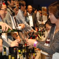 The perfect pour: Revelers at Festivin line up to try natural wines, which have gained popularity in Japan since the 1990s. | FESTIVIN