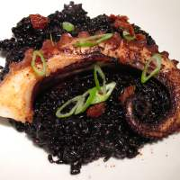 Black beauty: Le Verre Vole a Tokyo, an offshoot of a celebrated Parisian bistro, serves such delicacies as  black rice 'risotto' with octopus. | ROBBIE SWINNERTON