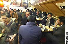After-work socializing, or 'tsukiai,' usually involving driking, is an integral part of life in the Japanese company.