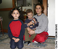 Meryem Dogan with chilldren, Mehmet, are pictured in a charity home for refugeen in Tokyo.