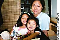 Filipino Rosanna Tapiru is fighting a legal battle to secure the futures of Japan-born daughters Masami (left) and Naomi.