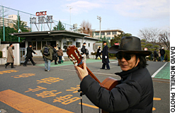 Every morning, Testsuo Tanaka, a former employee, performs his peace songs outside the Oki factory in Takao, west Tokyo, from 8-8:30 a.m.