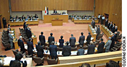 Tottori Prefectural assembly members stand in support of a discrimination and human rights ordiance on Oct. 12, 2005.