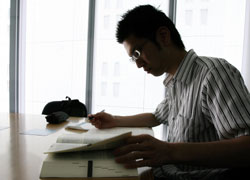 Twenty-five-year-old law school graduate Hiroyuki Ichikawa prepares for his lawyers' examinations in July. In past years, Ichikawa would have been looking at an almost impossible task, a bar exam failed by 97 percent of those who took it. Now, his chances are closer to 50-50. | AP PHOTO