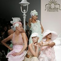 Models sporting unattractive frosted hairdos and sickly pastel-colored dresses pose en tableau vivant at the most recent Theatre Products show; Performance art unit Kathy and actor Mame Yamada star in one of the photographs on display at the 'Theatre Products no Genba' exhibition on show at Parco Museum.