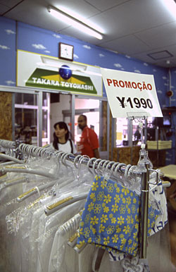 Customers browse at a Brazilian store in Toyohashi City, Aichi Prefecture. | TONY McNICOL PHOTO