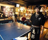 Table tennis has begun popping up in such unlikely places as One, a bar and BBQ house run by Yuichi Uchida (top) in Nogata, Tokyo, and Famitaku, which is located in a Family Mart convenience store in Jinbo-cho. | YOSHIAKI MIURA PHOTOS