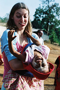 Go-Mad volunteer Sarah Ryder upends a student at the Baan Unrak school in Thailand (top), while (below top) a JET teacher leads students in song at Panskura School in India and (bottom) a student at Baan Unrak makes a Christmas card. | KATHRYN VIGNA, LAUREN MESSING PHOTOS