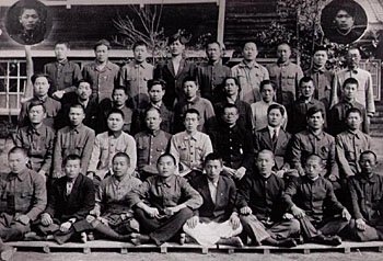 Young members of Aso Mining's large Korean forced labor workforce pose in front of the Yamato dorm at the Atago Mine in 1943. Most Korean labor conscripts were never properly paid. | PHOTO COURTESTY OF EIDAI HAYASHI