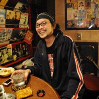 Bon Yamamoto striked a familiar pose in Kaze no Mori, a bar in Golden Gai in Tokyo's Shinjuku district.
