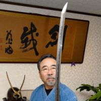 Iron in the soul: Swordsmith Yoshindo Yoshihara eyes a chunk of the basic  tamahagane  steel (above) from which he makes his swords (below). | YOSHIAKI MIURA PHOTO
