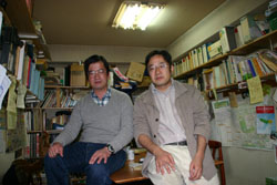 Tried, convicted: Toshiyuki Obora (left) and Nobuhiro Onishi of the Tachikawa Tent Village pose in the antiwar group's cluttered office. | DAVID McNEILL PHOTO