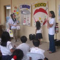 Good tooth, bad tooth: KADVO workers teach children the rudiments of good dental care.