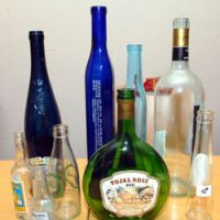 Glass feeling: Used glass bottles that La MARS members use as musical instruments (above), and the trio performing at an Apple Store in Tokyo's posh Ginza district in February (below). | YOSHIAKI MIURA PHOTO; La MARS PHOTO