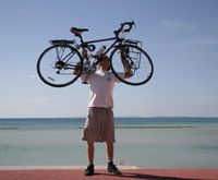 Leigh Norrie reaches Minamihama, Okinawa, at the end of a 10,000-km bicycle ride across Japan.