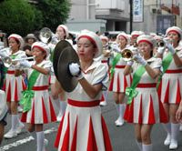 Marching to the beat: The Sogo Keibi Joshi Gijotai girls brass band, one of several brass bands at the Anjin Festival, particpates in the parade. | MIO YAMADA PHOTO