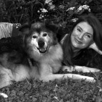 Best friends: Briar Simpson, Tokyo representative for Animal Refuge Kansai, poses with her dog, Alpha, with whom she spent six happy years until his death earlier this year at the age of 17. | TAKAYUKI OSUMI PHOTO