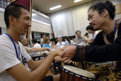 Don't mind the gap: Universal Camp attendees learn drumming, party with the locals and get a lesson in sign language on Hachijojima, one of the Izu islands, last month | TONY McNICOL PHOTOS