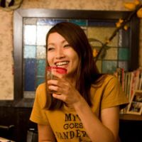 Off stage: Dance performer Ryoko Hashimoto relaxes in Yumeji, a bar she works at in Golden Gai, in Tokyo's Shinujuku. | KONGO RODRIGUEZ