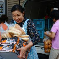 Helping hands: A worker for the House of Hope hospice in Tokyo's Sanya area picks up supplies from a Second Harvest delivery. | CARIN SMOLINSKI