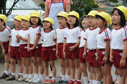 Ready to go: Youngsters at Kobato Nursery line up before taking part in the World Harmony Run in Kanagawa's Kamakura.
