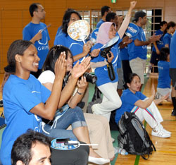 Supporters of multinational volleyball teams GRIPS 1 & 2 (above) cheer for their players. | YOSHIAKI MIURA PHOTOS