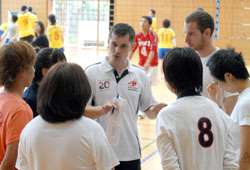 Volleyball players taking part in the World Amity Games Tournament on Aug. 1 engage in serious strategy planning between matches.