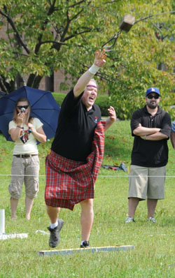 Let'er rip: A contestant in a heavy event (above) gives it his all, while another throws a hammer at the Scottish Highland Games on Oct. 4 at Kanda University of International Studies in the city of Chiba.