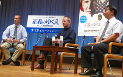 Gotta have ninjō?: Chris Burgess (left), broadcaster Peter Barakan and Wataru Sawamura, foreign editor at the Asahi Shimbun, take part in a discussion at Yurakucho Asahi Hall in Tokyo last month following a special screening of 'Crossing Over.'
